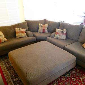 Lot #27- 3 piece sectional couch with large ottoman