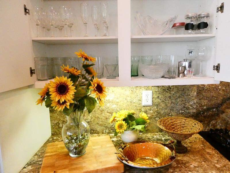 Lot #37-  Glassware, heavy duty butcher block  and fun kitchen decor! (main image)