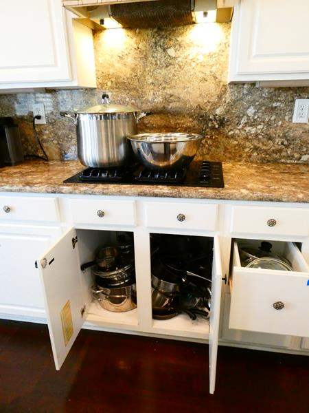 Lot #40-  Pots, pans, mixing bowls and large stock pot (main image)