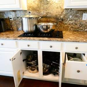 Lot #40-  Pots, pans, mixing bowls and large stock pot