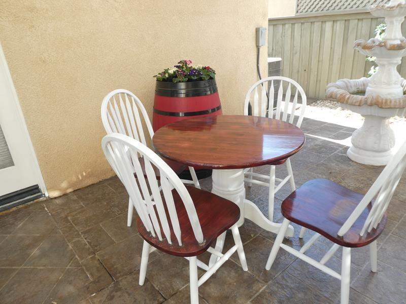 Lot # 158- Cozy farmhouse style outdoor/indoor table + chairs (main image)
