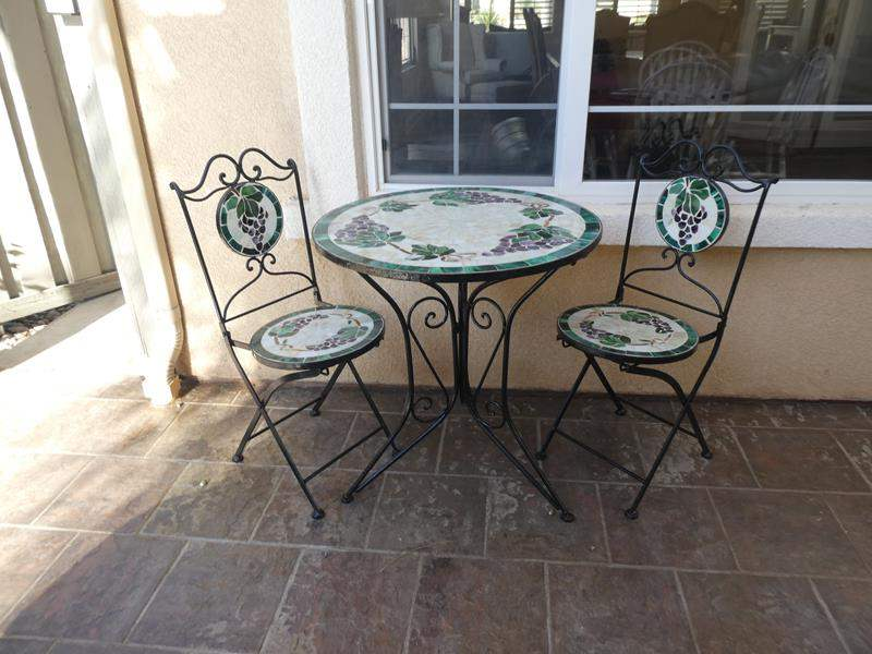 Lot # 160 - Bistro style patio set- Beautiful iron, tile topped patio table! (main image)