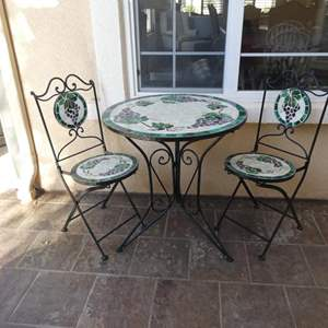 Lot # 160 - Bistro style patio set- Beautiful iron, tile topped patio table!