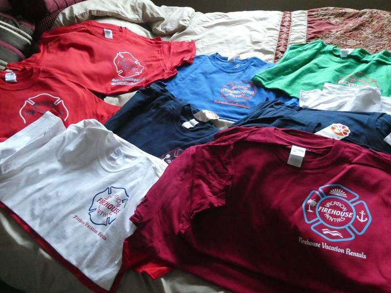 Lot # 179 - FDNY memorial shirts, local firehouses from across the country, and brand new firehouse shirts (main image)
