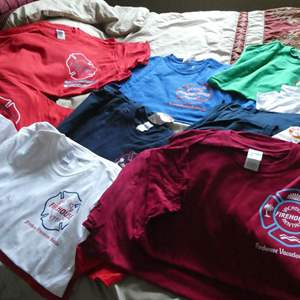 Lot # 179 - FDNY memorial shirts, local firehouses from across the country, and brand new firehouse shirts