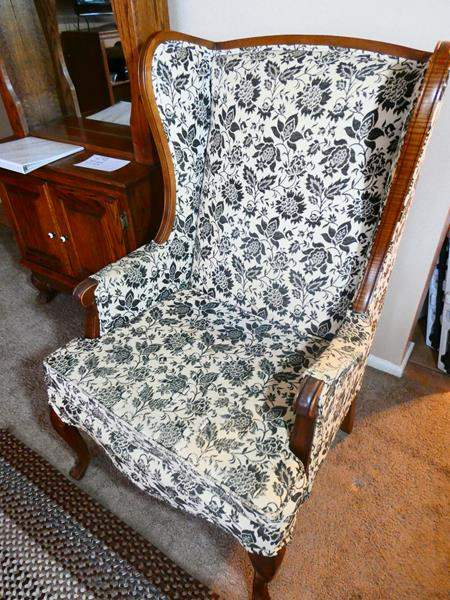 Lot # 2- Antique black and white wingback chair (main image)