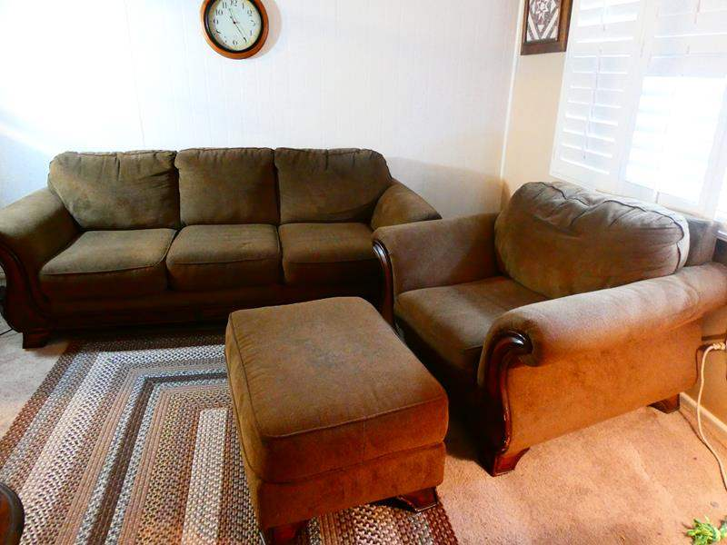 Lot # 4- Brown cloth couch- Includes chair and ottoman! Good condition  (main image)
