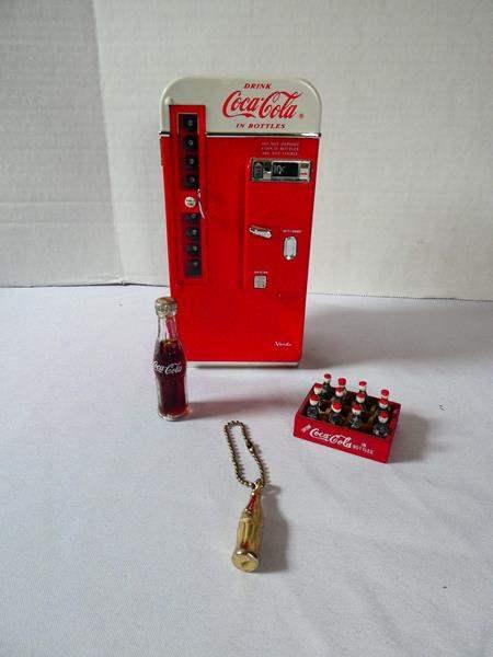 Lot # 129 Coca-Cola Vending Machine Piggy Bank and More! (main image)