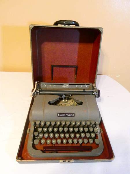 Lot # 25- Antique Underwood typewriter- Includes storage box (main image)