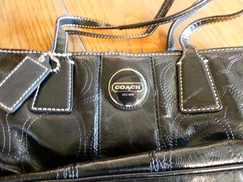 Lot # 31- Black COACH purse. Brand New! (main image)