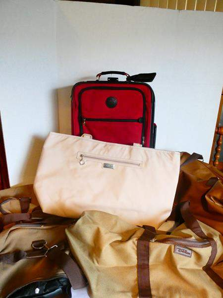 Lot # 34- New Belle Russo duffle bag and assorted luggage (main image)