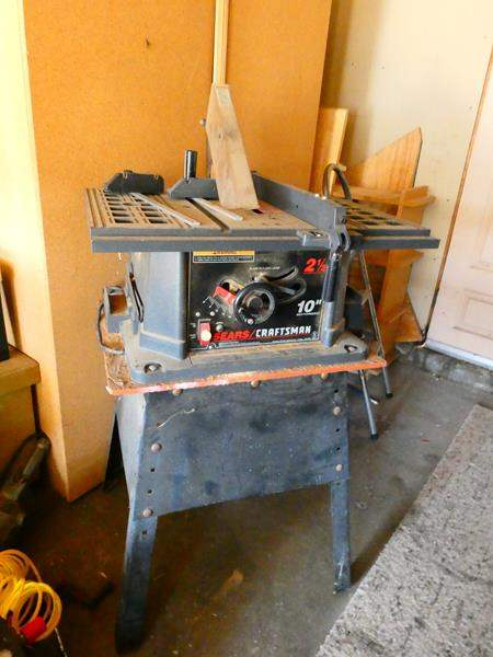 "Lot # 158- Craftsman/ Sears 10"" motorized table saw (main image)"