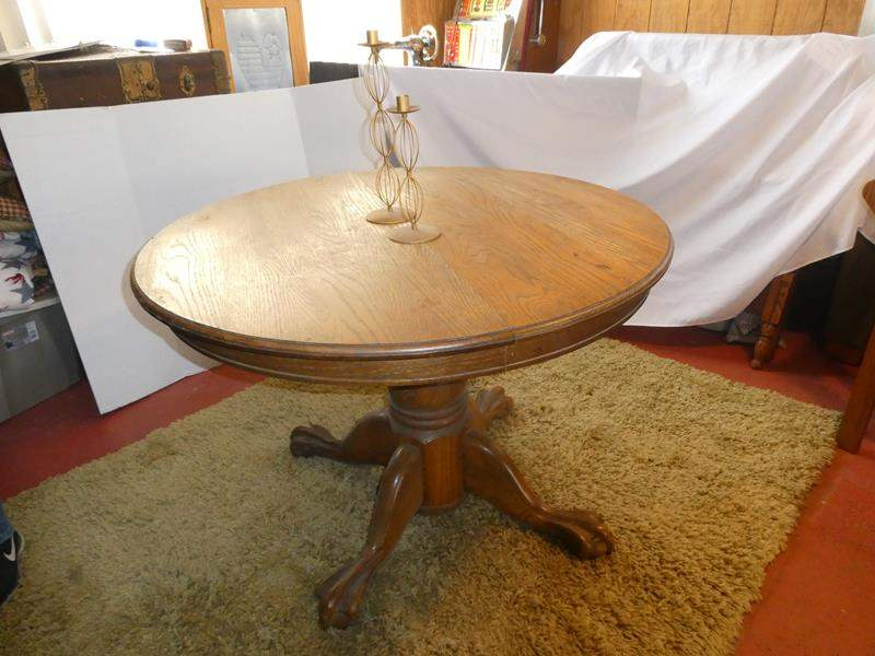 Lot # 51- Solid oak table, rug & candlesticks (main image)