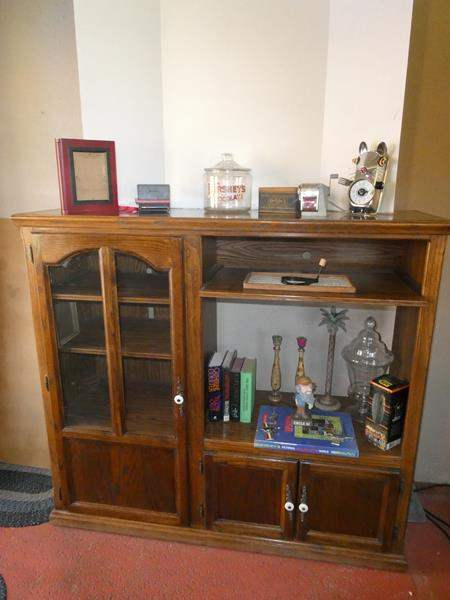 Lot # 58- Oak hutch- Includes fun collectables! Look at all the pictures. (main image)