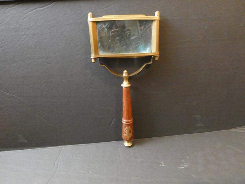 Lot # 59- Antique hand magnifying mirror (main image)