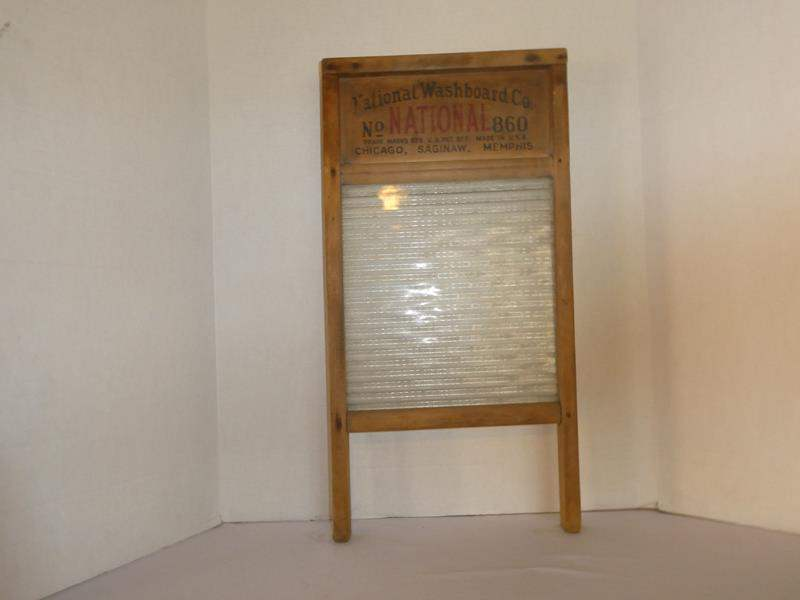 Lot # 75- Vintage washboard with gorgeous glass in the middle! (main image)
