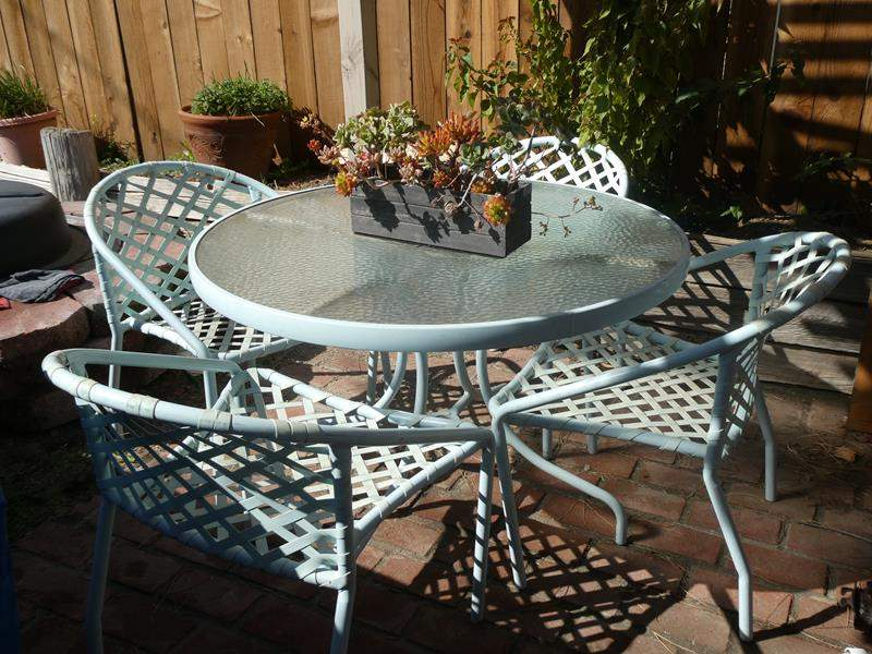 Lot # 78- Glass patio table with chairs with nice succulent plant (main image)
