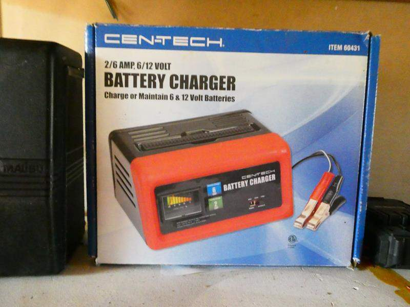 Lot # 195- Cen Tech battery charger in box (main image)