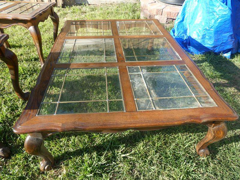 Lot # 93- Coffee table with 2 matching end tables: 3 Wood tables with glass table tops  (main image)