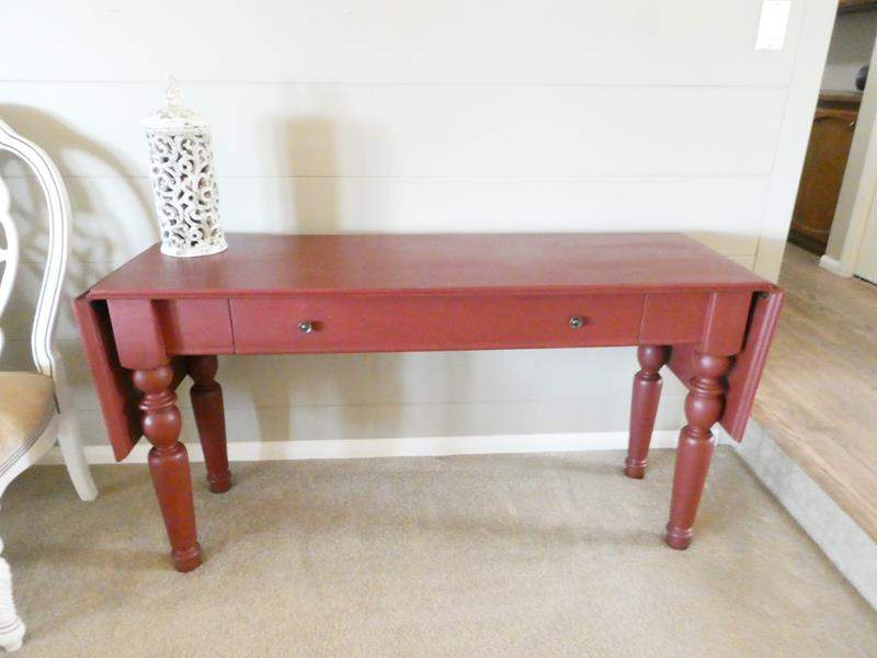 Lot # 2- Red sofa table + white ceramic fancy candle (main image)