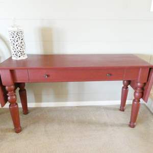 Lot # 2- Red sofa table + white ceramic fancy candle