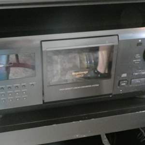 Lot # 58- SONY CD Player with 200 CD'S!