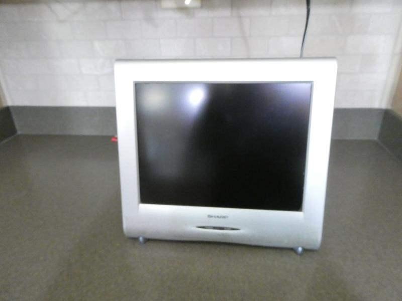 Lot # 72- SHARP Small Kitchen TV (main image)