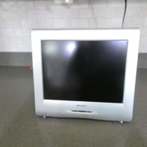 Lot # 72- SHARP Small Kitchen TV