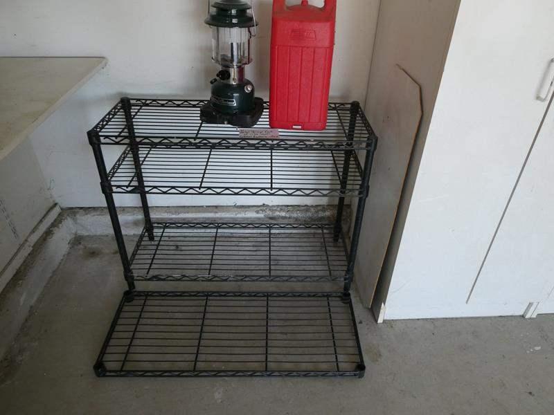 Lot # 82- Metal Storage Rack and Coleman Lantern (main image)