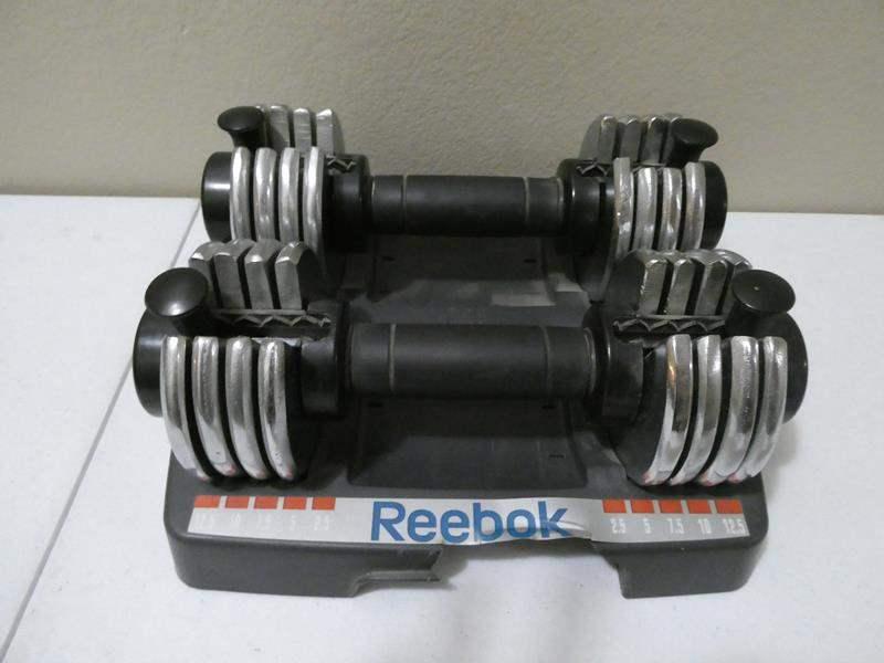 Lot # 102- Reebok Adjustable Dumbells (main image)