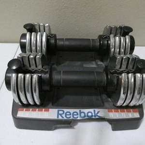 Lot # 102- Reebok Adjustable Dumbells