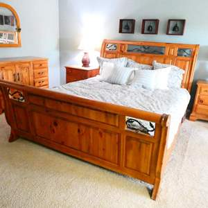 Lot # 36-  Cal King Size solid wood/wrought iron bed, Mattress and Bedding included
