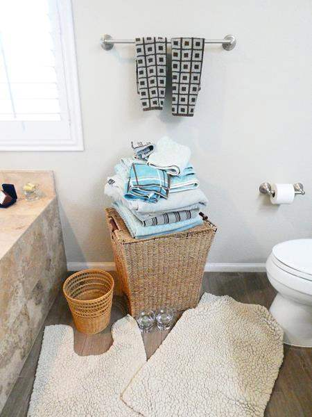 Lot # 43-Ocean Blue & Tan Bathroom Towels with basket, hamper, rugs  and candles (main image)
