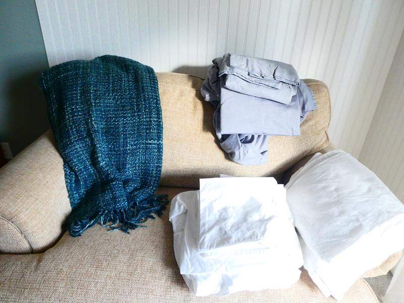 Lot # 49- one set King sheet set, one set full, along with an Crate and Barrel afghan (main image)