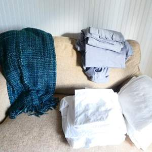 Lot # 49- one set King sheet set, one set full, along with an Crate and Barrel afghan