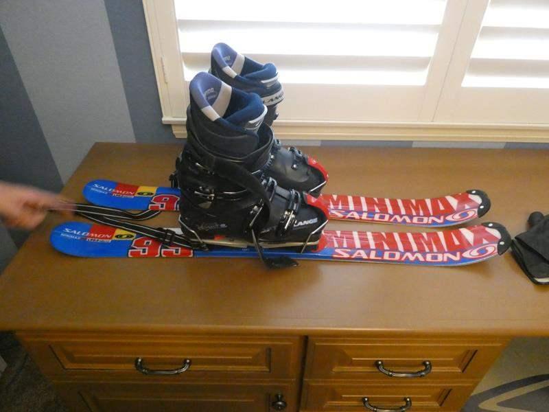 Lot # 118- Salomon skis with Lange boots- size 8 (main image)