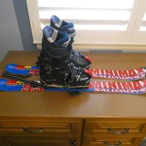 Lot # 118- Salomon skis with Lange boots- size 8