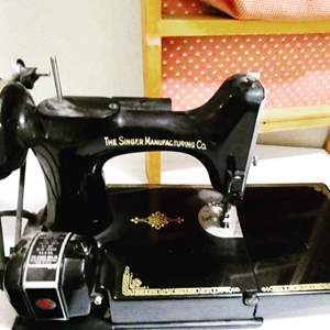 Lot # 50-Singer Featherweight -With Centennial Badge- Antique Sewing Machine, Buttonholer and Supply cabinet