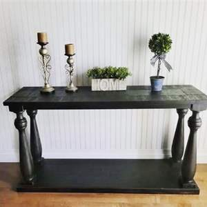 Lot # 53- Large Dark Wood Sofa Table & 2 Candles (some décor not included)