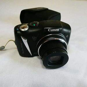 Lot # 210- Canon cameral- new condition- tested