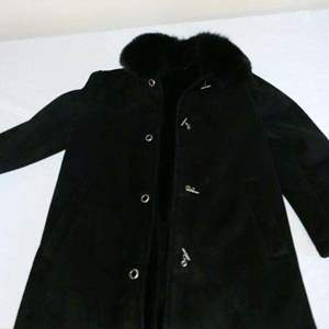 Lot # 214- Dana Buchman, long heavy jacket- size L- lined with fur color