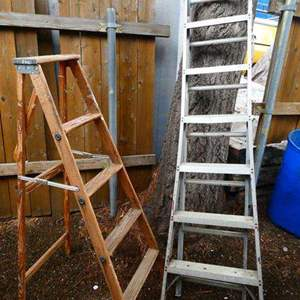 Lot # 219- Two ladders- one wood, one aluminum/ extends