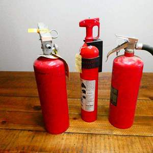 Lot # 223- Three fire extinguishers- See all pictures- three sizes