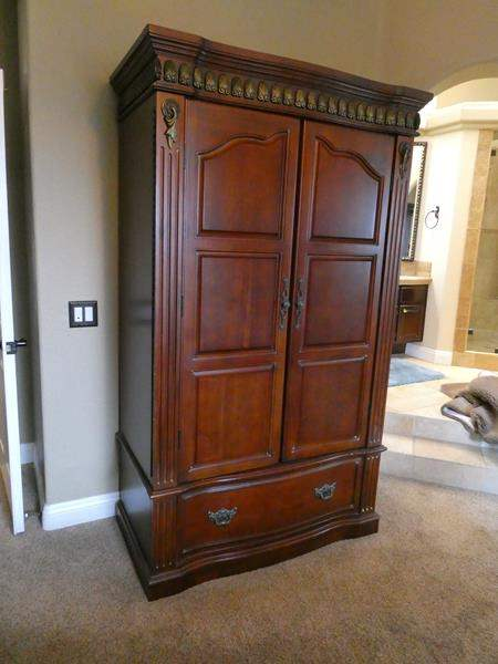 Lot # 104- Beautiful, solid wood armoire (main image)