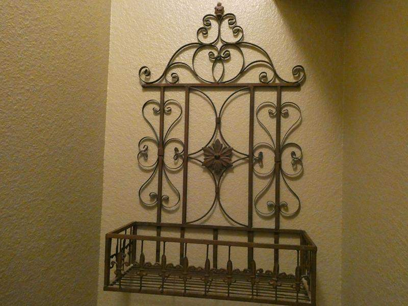 Lot # 109- Metal towel rack with four matching pictures (main image)