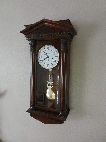 Lot # 115- Howard Miller wall clock (main image)