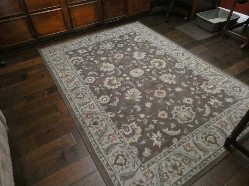 Lot # 130- Brown area rug (main image)