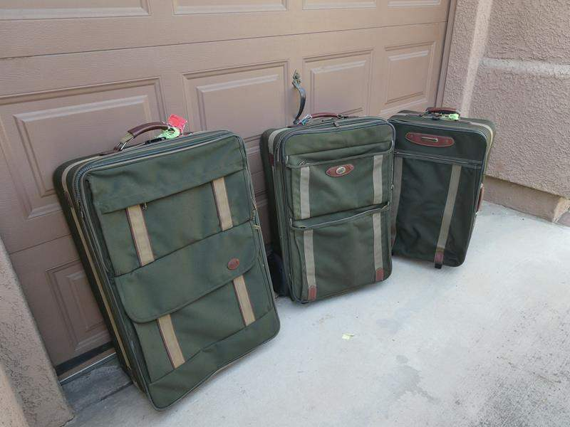 """Lot # 137- """"American Tourist"""" suitcases (main image)"""