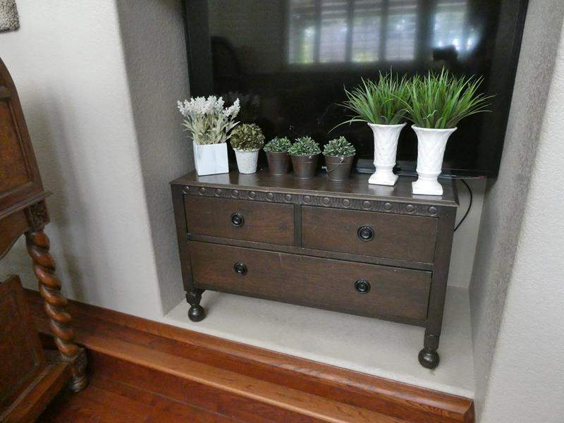 Lot # 144- Cute wood accent table with decor (main image)