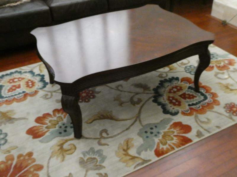 Lot # 147- Coffee table and area rug (main image)